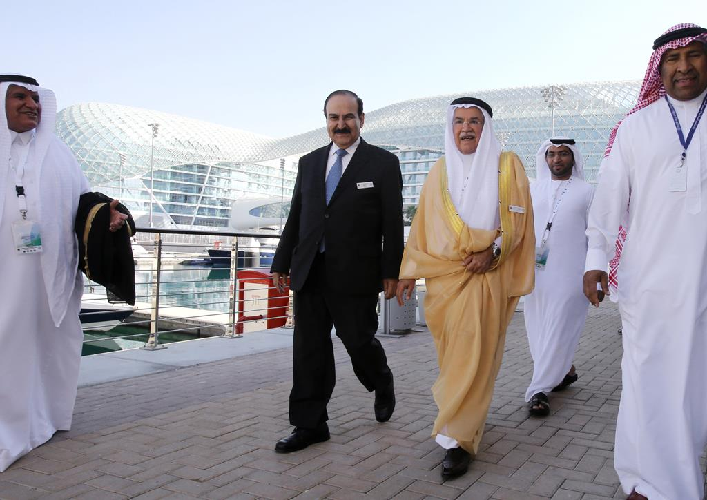 Saudi Arabia's Minister of Petroleum and Mineral Resources Ali Ibrahim Naimi, third right, walks back to the conference hall after his lunch break during the opening day of the 10th Arab energy Conference in Abu Dhabi, United Arab Emirates, Sunday, Dec. 21. (AP Photo/Kamran Jebreili)