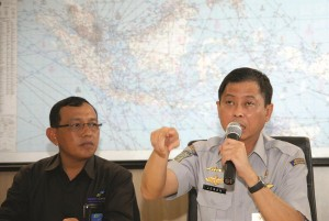 In this photo released by China's Xinhua News Agency, Indonesian Transport Minister Ignasius Jonan (R) speaks at a press conference on AirAsia's missing flight QZ8501 at Juanda International Airport in Surabaya, East Java, Indonesia, Sunday. (AP Photo/Xinhua, Syaiful Arif)