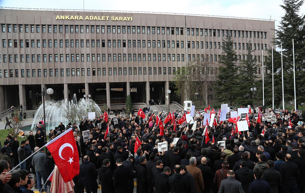 People gather outside the Palace of Justice in Ankara, Turkey, Monday to protest against the latest detentions of journalists.  (AP Photo)