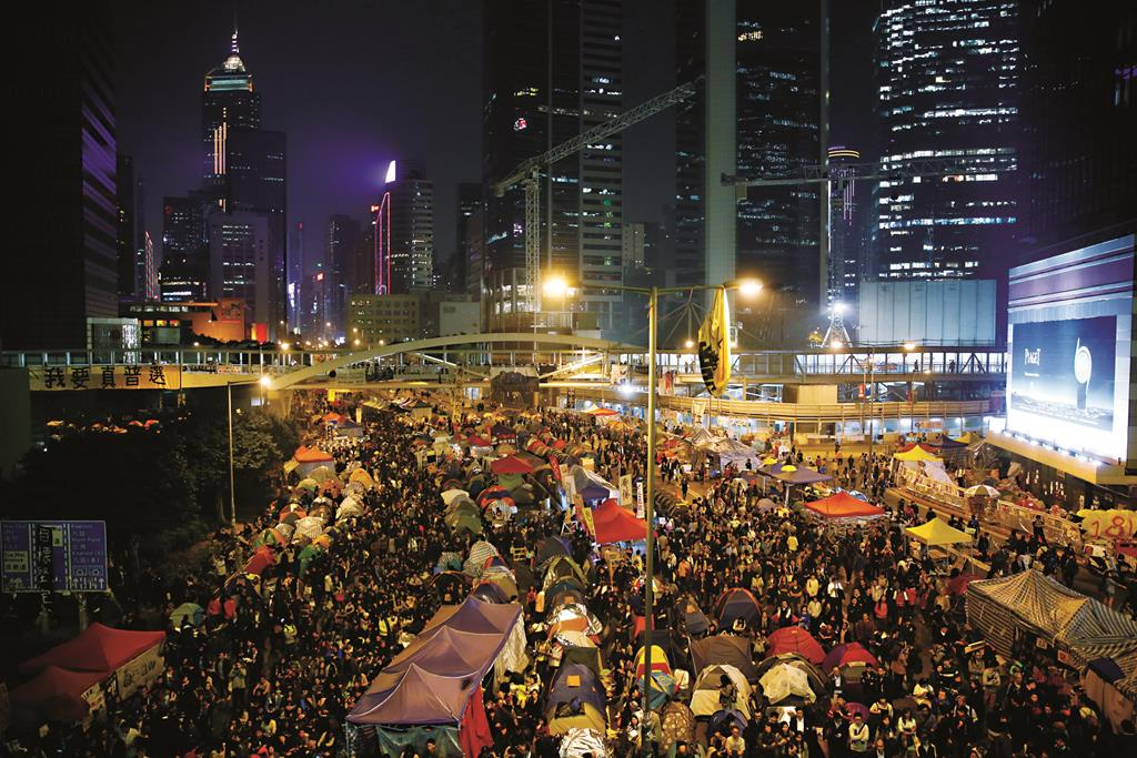 Pro-democracy protesters' colorful tents are seen along a main road at the occupied area outside government headquarters in Hong Kong Wednesday (AP Photo/Kin Cheung)