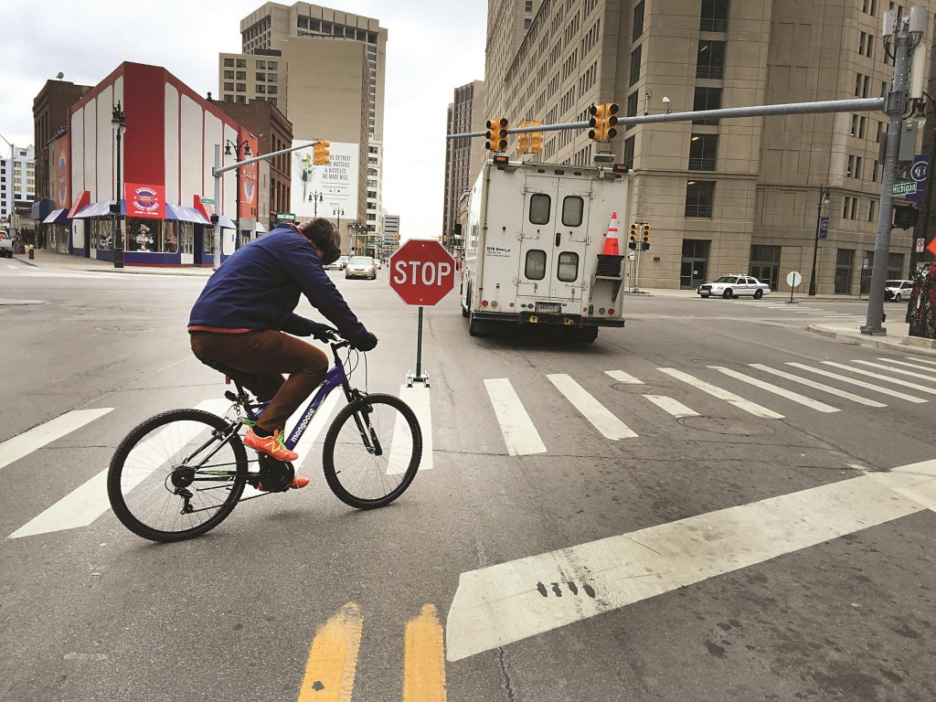 Temporary stop signs are placed in the middle of Michigan Ave. after the Detroit downtown area was hit by a massive power outage, Tuesday. (AP Photo/Detroit Free Press, Diane Weiss)