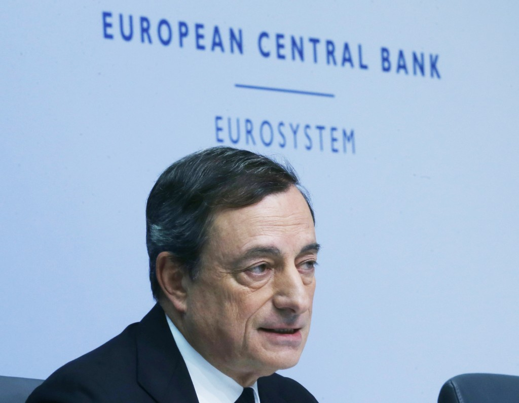 European Central Bank President Mario Draghi speaks during a news conference in Frankfurt, Germany, on Thursday, Dec. 4, 2014, following a meeting of the ECB governing council. (AP Photo/Michael Probst)