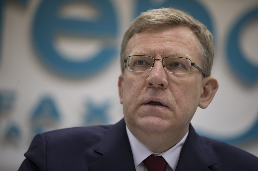 Alexei Kudrin speaks during a news conference in Moscow, Russia, on Monday, Dec. 22, 2014. Kudrin, Russia's finance minister from 2000-2011, has predicted a major economic crisis in Russia next year even if the price of oil, the backbone of the Russian economy, goes up. (AP Photo/Pavel Golovkin)