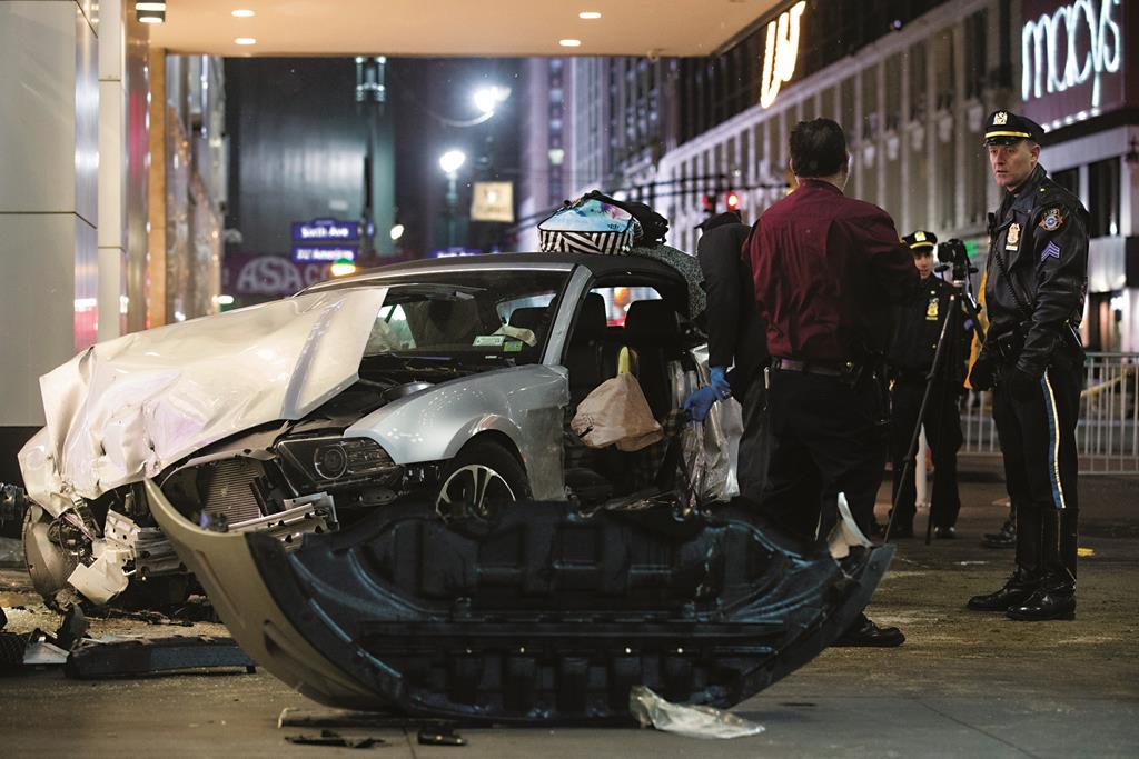 Police on Thursday at the scene of a vehicular accident near the Empire State Building. (AP Photo/John Minchillo)