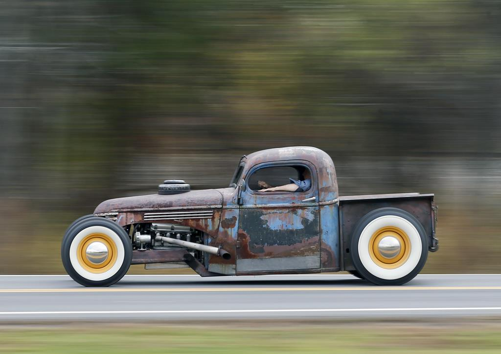 Peter Duvaloois on Tuesday drives his Rat Rod near his shop in Saugerties, N.Y. (AP Photo/Mike Groll)