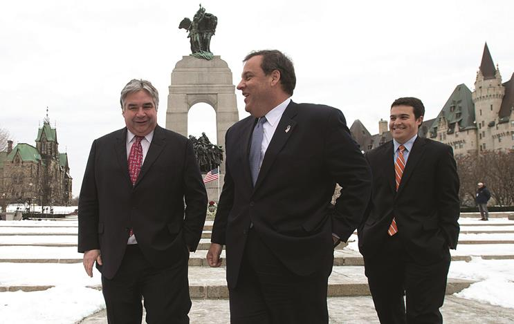 Government House Leader Peter Van Loan on Friday speaks with Gov. Chris Christie and his son Andrew after a visit to the National War Memorial in Ottawa. (AP Photo/The Canadian Press, Adrian Wyld)