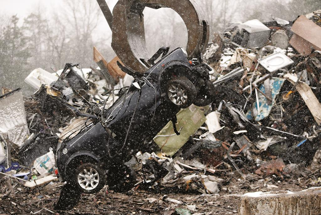 An imported Austin Mini Cooper is demolished Thursday at Price's Auto Recyclers in Plumsted, N.J. (AP Photo/Julio Cortez)