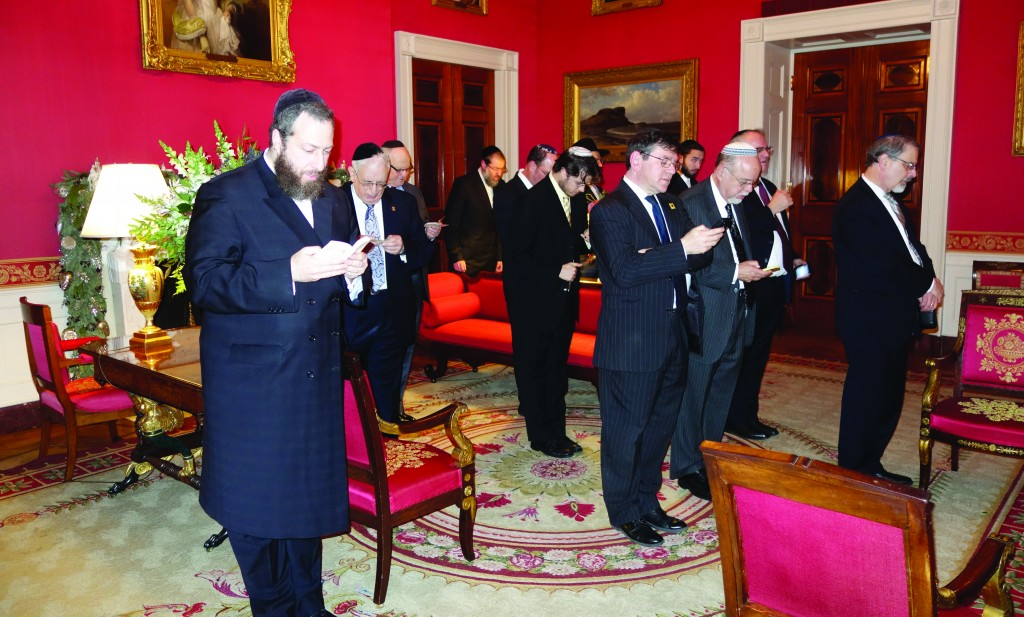 Davening Minchah in the Red Room, in the White House, December 17, 2014.