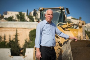 Outgoing Israeli Minister of Housing and Construction Uri Ariel (Jewish Home), posing at a construction site in Ramot, Yerushalayim, a few days ago. (Yonatan Sindel/Flash90 )
