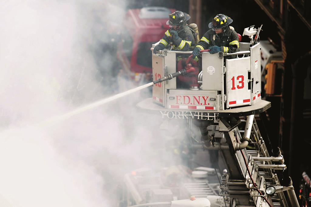 New York City's Fire Department is on pace to have its busiest year on record. (AP Photo/John Minchillo)