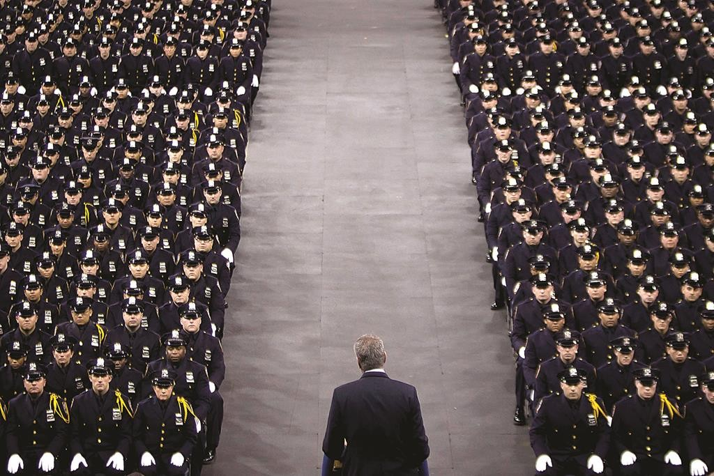 Mayor Bill de Blasio met with leaders of the five NYPD unions on Tuesday to attempt to tamp down the anger of police rank-and-file in the wake of recent anti-police protests. On Monday the mayor spoke from the podium to the NYPD Academy graduating class in Queens.  (Reuters/Carlo Allegri)