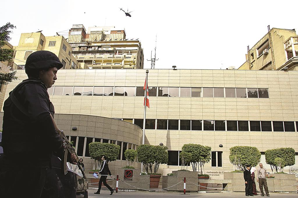 Security forces are deployed in front of the Canadian embassy in Cairo, Egypt, which closed to the public on Monday over security concerns. (AP Photo/Ahmed Abd El Latif, El Shorouk Newspaper)