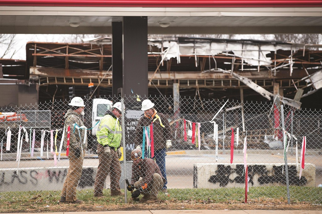 Workers repair a fence that surrounds a business that was destroyed by rioting Tuesday in Ferguson, Missouri. (Scott Olson/Getty Images)