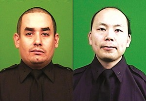 This combination made from photos provided by the New York Police Department shows officers Rafael Ramos (L) and Wenjian Liu.