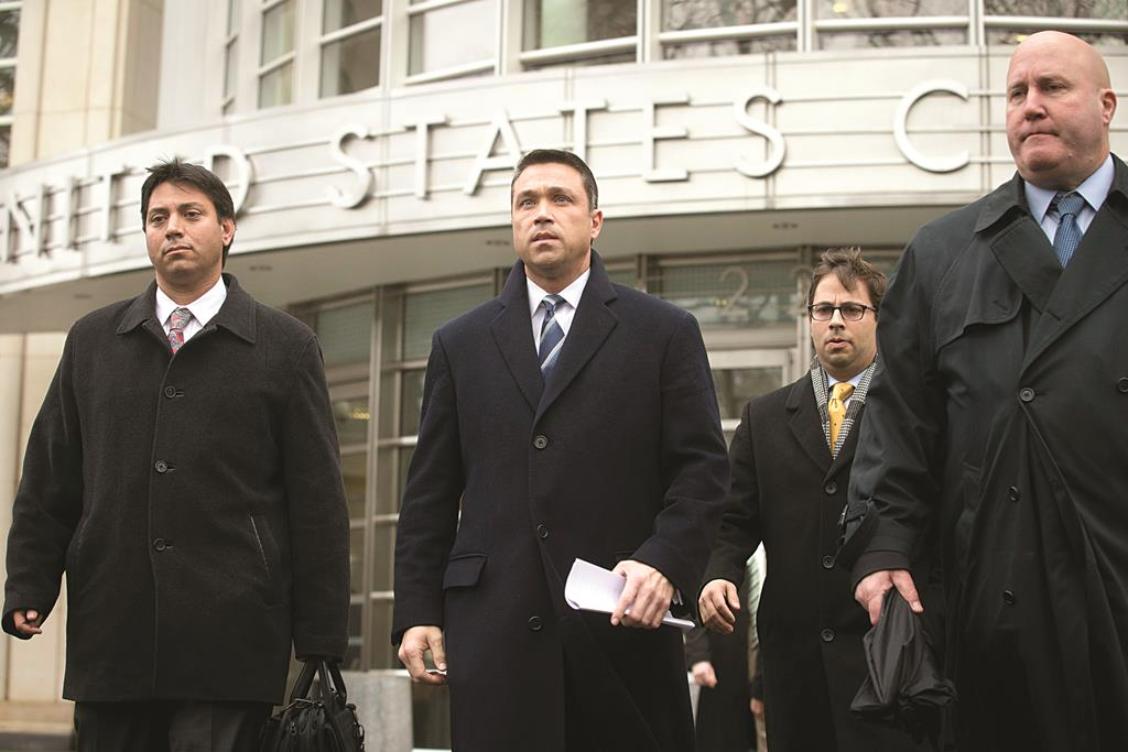 Rep. Michael Grimm on Tuesday leaves Federal court in Brooklyn after pleading guilty to a federal tax evasion charge rather than go to trial. (AP Photo/John Minchillo)