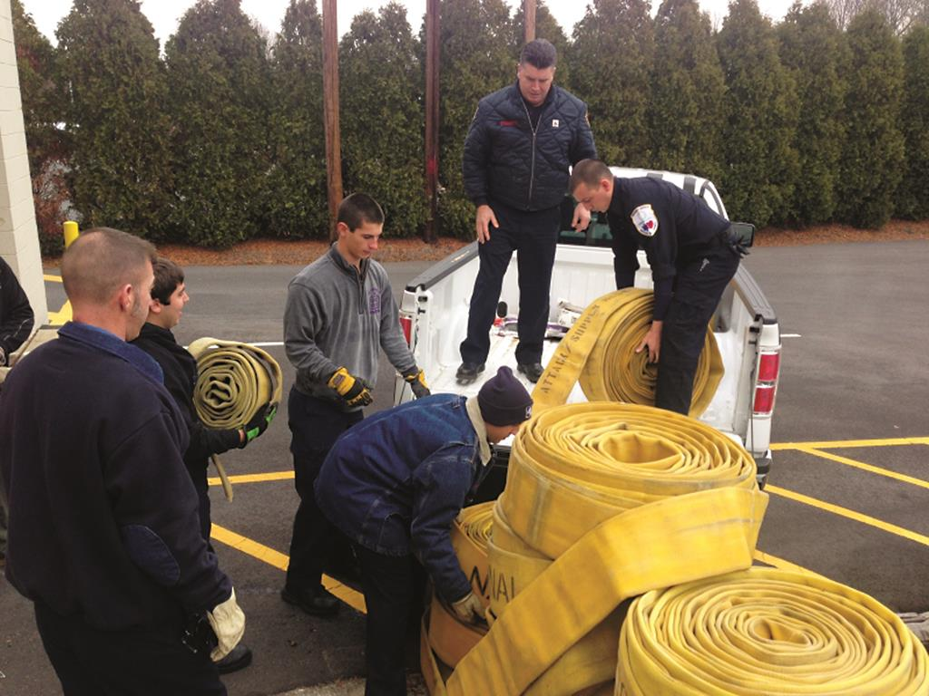 Robbinsville fire department workers unload defective fire hoses for use by Six Flags Great Adventure safari animals. (Robbinsville Fire Department)