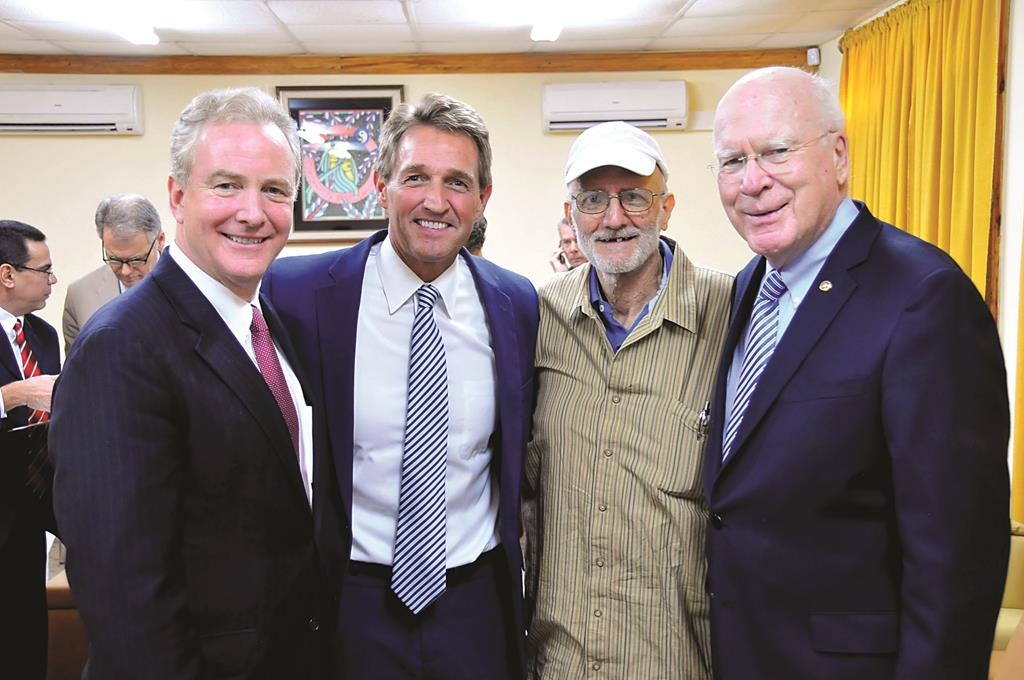 This photo courtesy of Sen. Patrick Leahy's office shows Alan Gross, second from right, with, from left, Rep. Chris Van Hollen, D-Md., Sen. Jeff Flake, R-Ariz., and Sen. Patrick Leahy, D-Vt., in Havana, Wednesday, before Gross's flight home, to the U.S.  (AP Photo/Courtesy of Sen. Patrick Leahy's office)