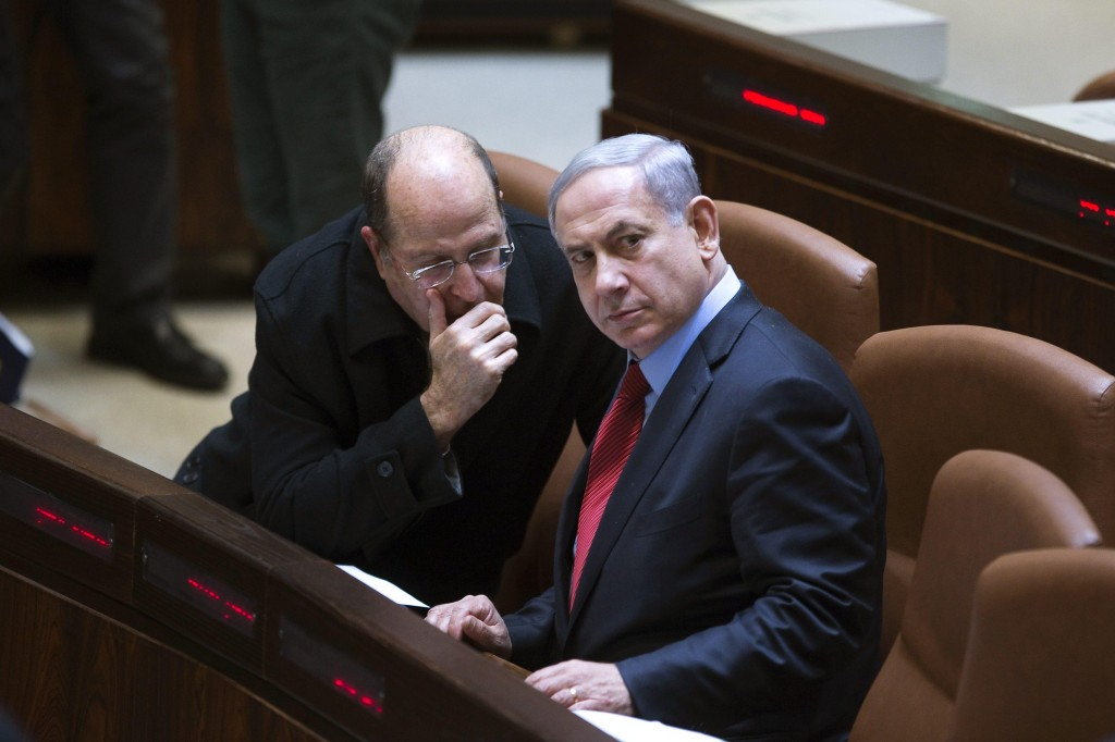 Israel's Defense Minister Moshe Yaalon (L) speaks with Prime Minister Binyamin Netanyahu during a session of the Knesset on Monday. (REUTERS/Ronen Zvulun)