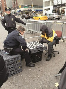 A police officer on Monday at a chess match in Manhattan. (Twitter)