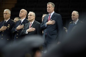Mayor Bill de Blasio and NYPD commissioner Bill Bratton, second from left, during a police graduation ceremony at Madison Square Garden.