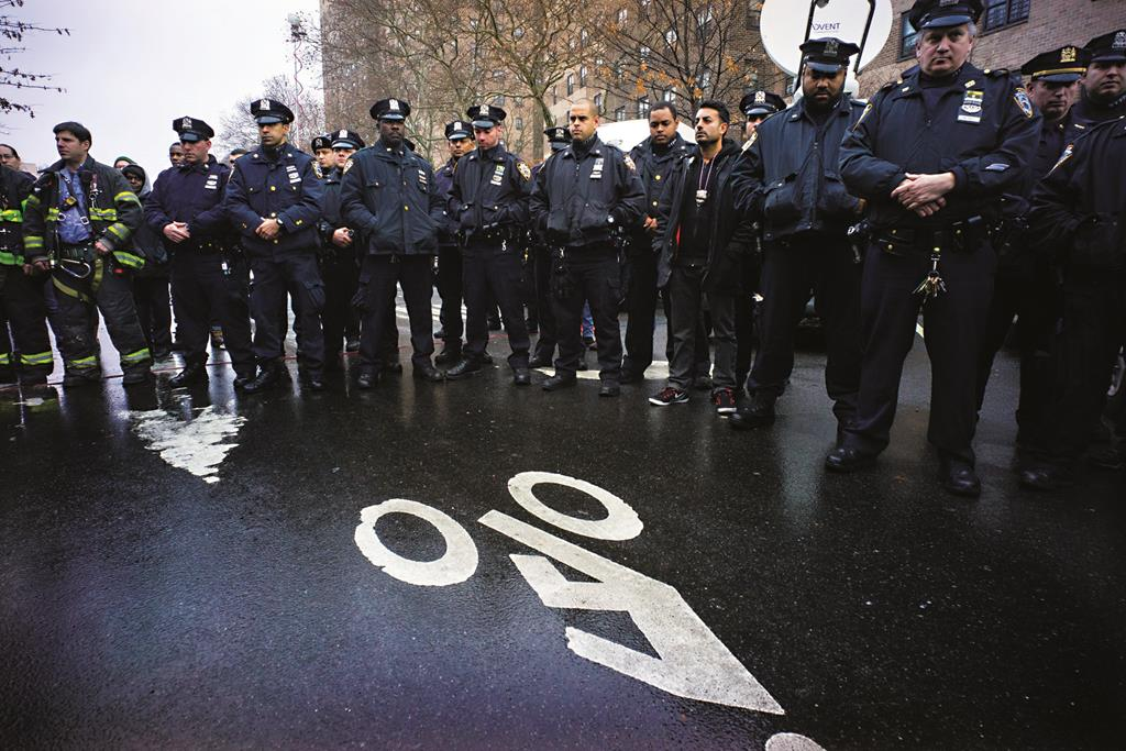 Law enforcement officials on Tuesday stand for a moment of silence at 2:47 p.m., exactly three days after two cops were killed in Brooklyn. (AP Photo/Craig Ruttle)