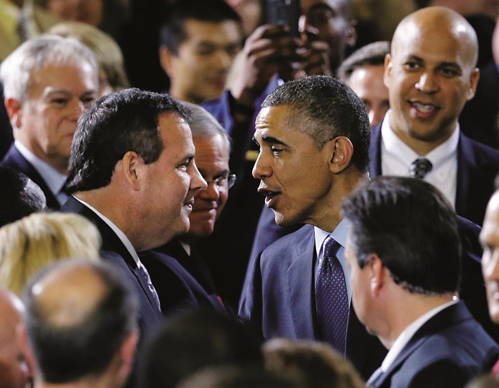 President Barack Obama on Monday greets Gov. Chris Christie after speaking to military members and families at Fort Dix, N.J. (AP Photo/Mel Evans)