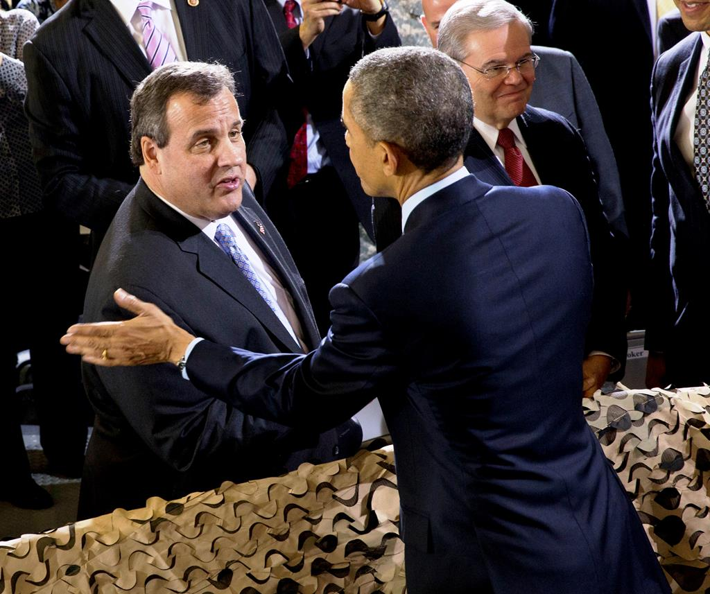 President Barack Obama on Monday talks with Gov. Chris Christie after speaking to troops at Joint Base McGuire-Dix-Lakehurst, N.J. (AP Photo/Jacquelyn Martin)