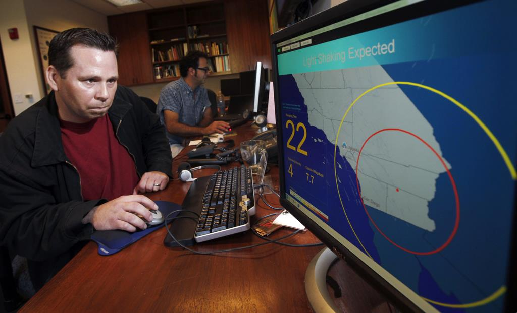 Anthony Guarino Jr., a seismic analyst at the California Institute of Technology, demonstrates an early earthquake warning system in Pasadena, Calif.  (AP Photo/Reed Saxon, File)