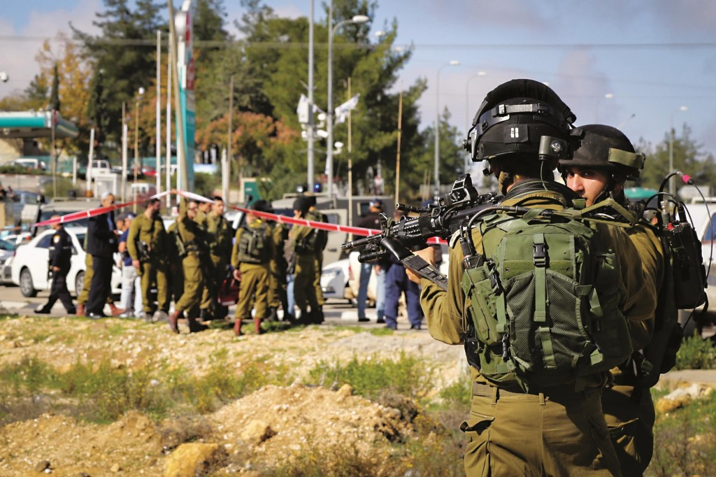 Israeli security forces at the site of a terrorist stabbing at the Gush Etzion junction on Monday. (Gershon Elinson/FLASH90)