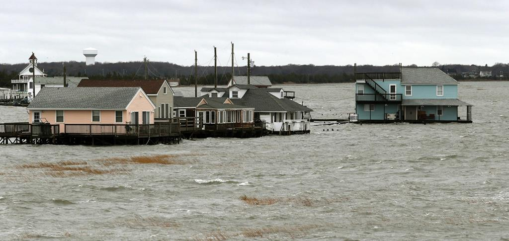 Homes in Middle Township, N.J., are surrounded by floodwater after Tuesday's northeast storm caused moderated tidal flooding. (AP Photo/The Press of Atlantic City, Dale Gerhard)