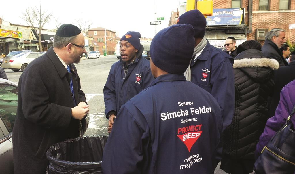 State Sen. Simcha Felder on Monday speaking with some of the men who will be cleaning 18th Ave. every weekday. (Office of Sen. Felder)