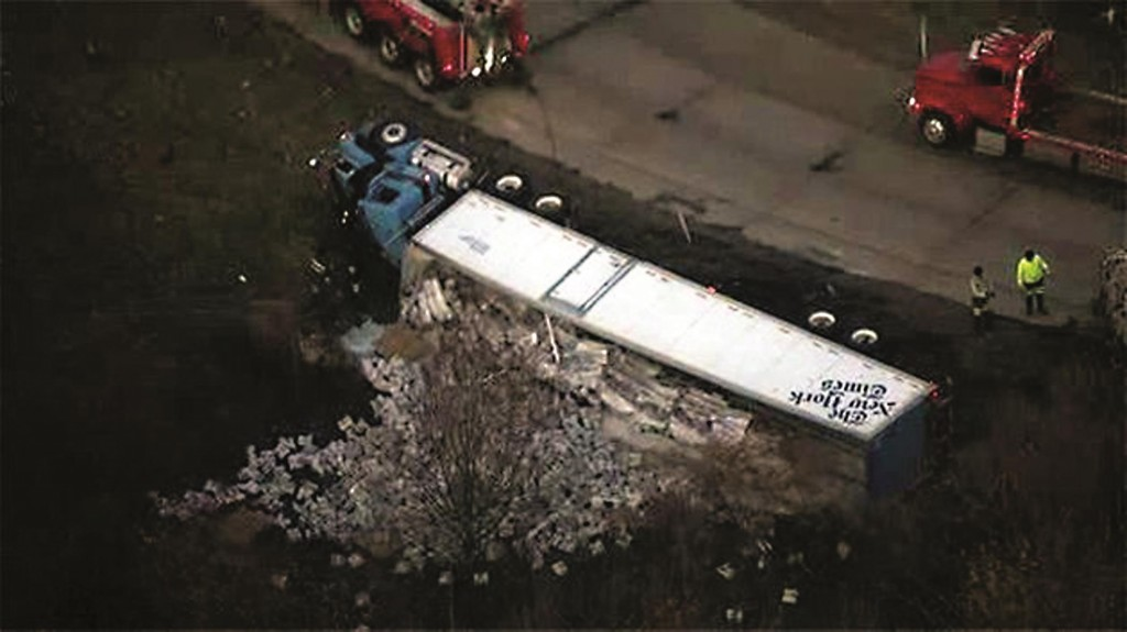 Thousands of copies of The New York Times lay spilled out on a Pennsylvania roadway Thursday after the delivery truck overturned. (Twitter)