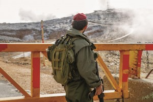 An Israeli soldier on duty on a snowy day in the Golan Heights.  (Ariel Hermoni/Ministry of Defense/FLASH90)
