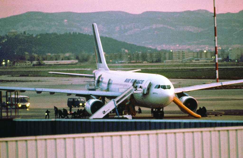 French anti-terrorist units storm a hijacked Air France Airbus A300 at the Marseille airport to rescue passengers and crew being held by terrorists on December 26, 1994.  (AP Photo)