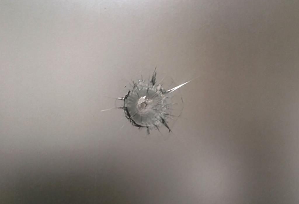 The hole in the window of the Paris synagogue that was targeted. (Photo: BNVCA)