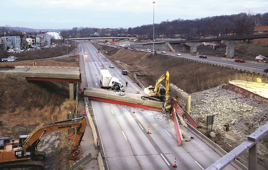 Work continues in the aftermath of the bridge collapse on Interstate 75, Tuesday. (AP Photo/The The Cincinnati Enquirer, Liz Dufour)
