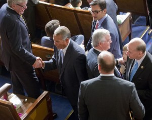House Speaker John Boehner of Ohio (C) shakes hands as he walks past Rep. Louie Gohmert (R-Texas) (R), as members of the House of Representatives gather for the opening session of the 114th Congress on Capitol Hill in Washington, on Tuesday, Jan. 6. (AP Photo/Pablo Martinez Monsivais)
