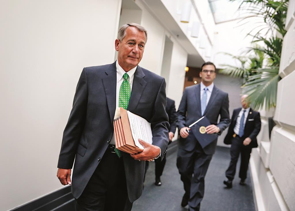House Speaker John Boehner of Ohio walks to a closed-door meeting with House Republicans, Wednesday, on Capitol Hill in Washington.  (AP Photo/J. Scott Applewhite)
