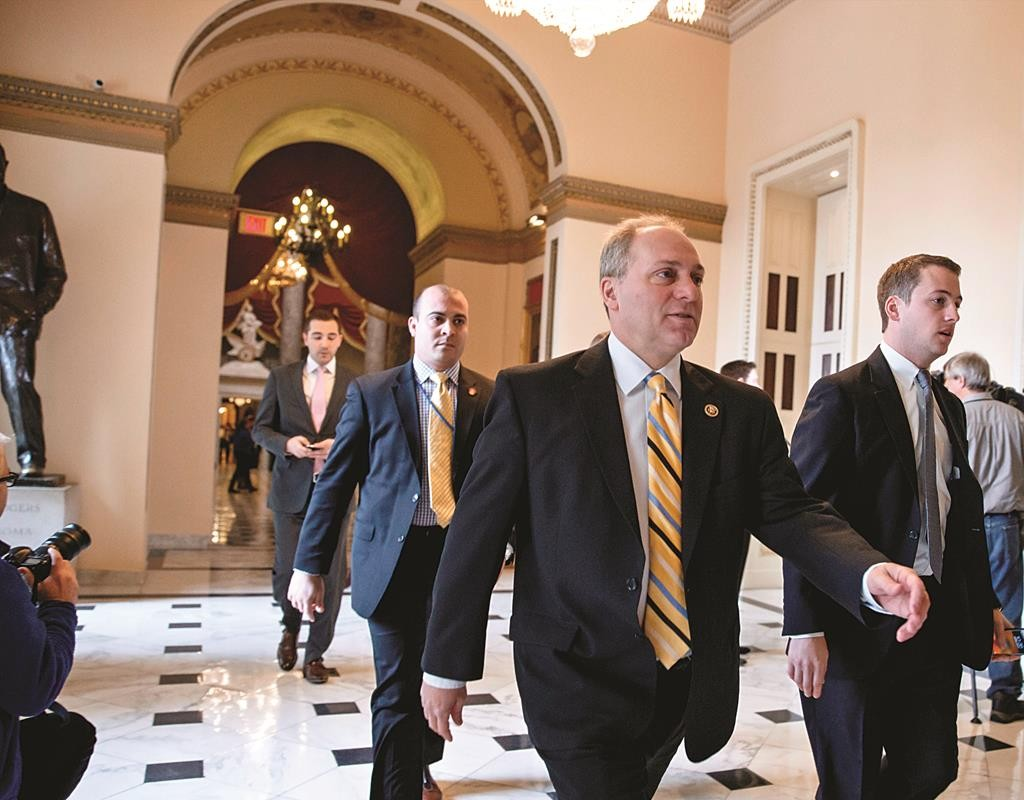 House Majority Whip Steve Scalise of Louisiana rushes to the House chamber on Capitol Hill in Washington, Wednesday, as lawmakers vote to fund the Homeland Security Department but will curb President Barack Obama's executive actions on immigration. (AP Photo/J. Scott Applewhite)