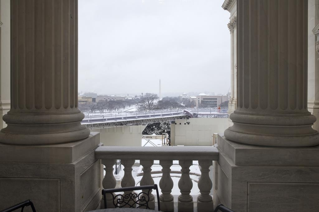 Snow blankets the National Mall as seen from the U.S. Capitol, Tuesday, on the start of the 114th Congress in Washington.  (AP Photo/Jacquelyn Martin)
