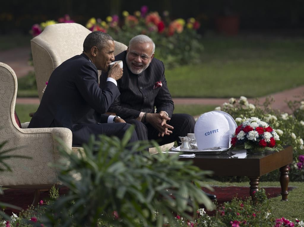 President Barack Obama and Indian Prime Minister Narendra Modi have coffee and tea in the gardens of the Hyderabad House in New Delhi, India, on Sunday. (AP Photo/Carolyn Kaster)