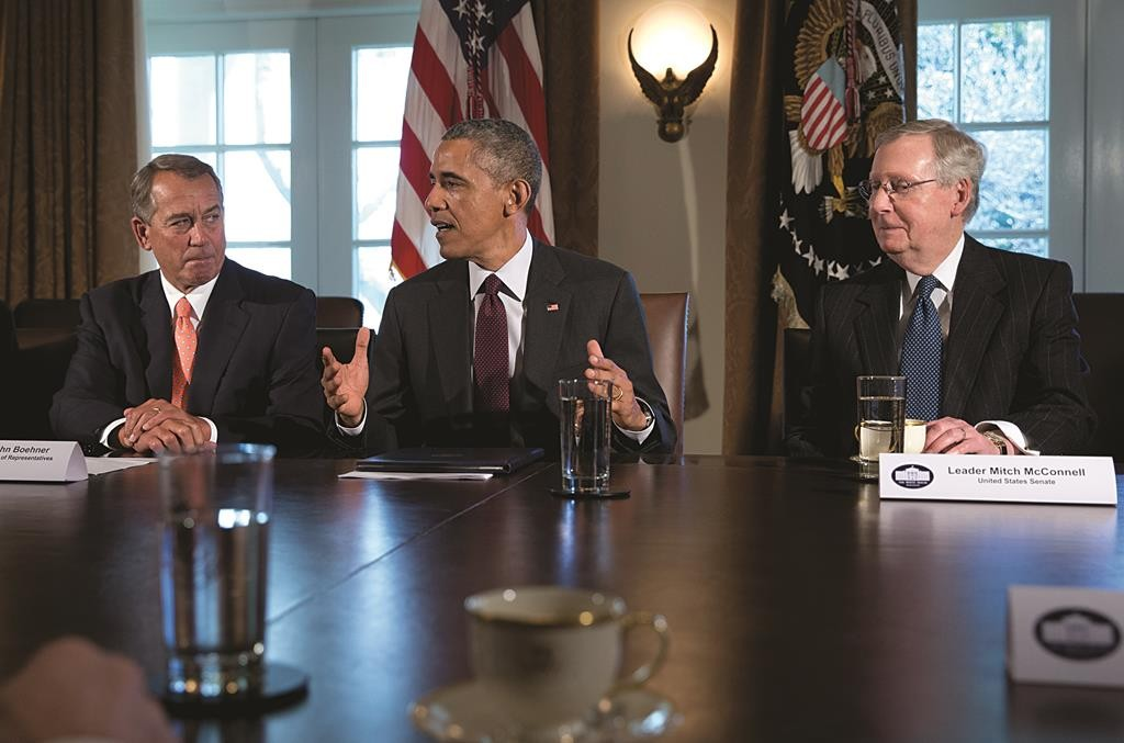 President Barack Obama, flanked by House Speaker John Boehner of Ohio, left, speaks to media as he meets with bipartisan, bicameral leadership of Congress.  (AP Photo/Carolyn Kaster)