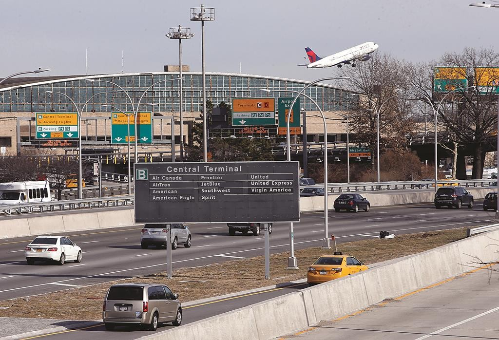Cars on the Grand Central Parkway pass LaGuardia Airport in New York. (APPhoto/Kathy Willens)