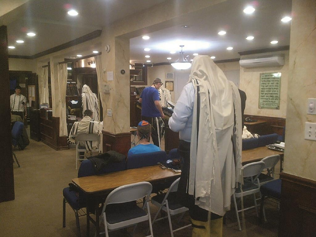 A larger crowd than usual walked to shul for an earlier minyan at Congregation Tifereth Tzvi in Cedarhurst Tuesday morning. Instead of davening later on a day the schools were closed and transit was shut down, Rabbi Pinchas Chatzinoff announced an earlier than normal minyan, so mispallelim davened k'vasikin — b'hiddur mitzvah — despite the need to walk in the snow.
