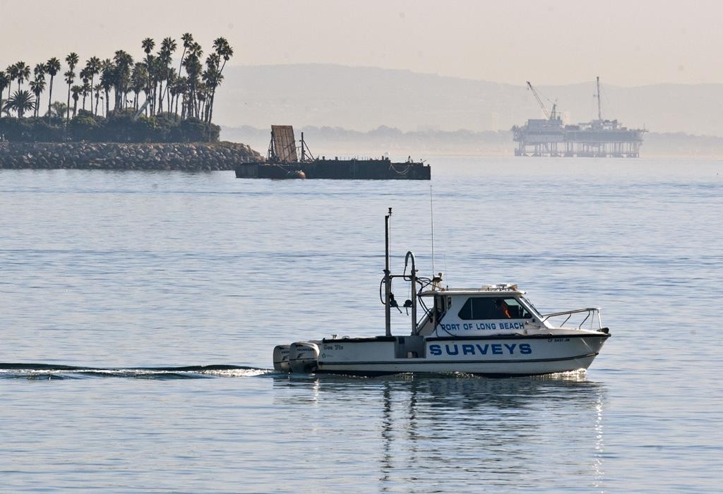 An oil rig is seen off shore in Long Beach, Calif., Wednesday, Jan. 14, 2015. The city where man-made islands built to pump oil sit just off shore, is deciding which capital projects can still move forward.  (AP Photo/Damian Dovarganes)