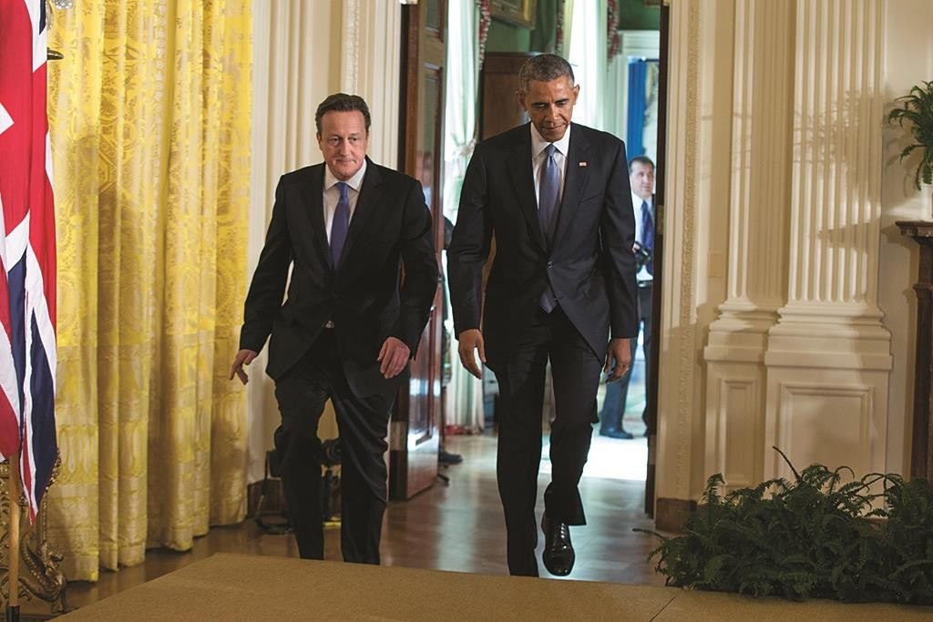 President Barack Obama and British Prime Minister David Cameron arrive for their joint news conference in the East Room of the White House in Washington, Friday. (AP Photo/Evan Vucci)