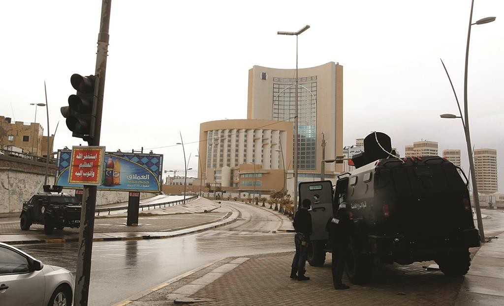 Security forces surround the Corinthia Hotel after it was stormed by gunmen, in Tripoli, Tuesday. (REUTERS/Ismail Zitouny)