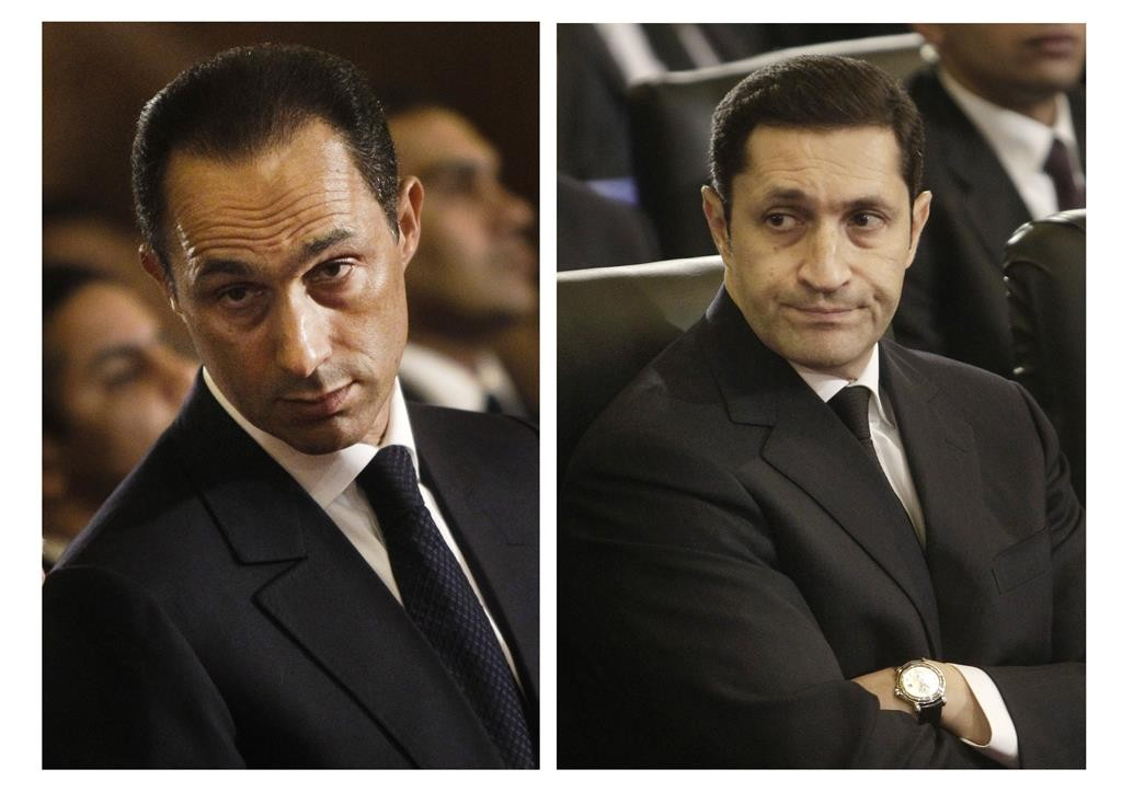 These file images show Gamal Mubarak (L) and Alaa Mubarak (R). Egyptian security officials said the two sons of ousted President Hosni Mubarak have been released from prison, nearly four years after they were first arrested along with their father.  (AP Photo/File)