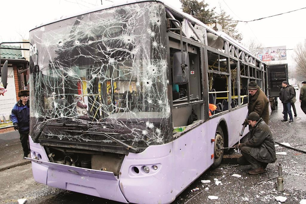A damaged trolleybus in Donetsk, Thursday. (REUTERS/Alexander Ermochenko)