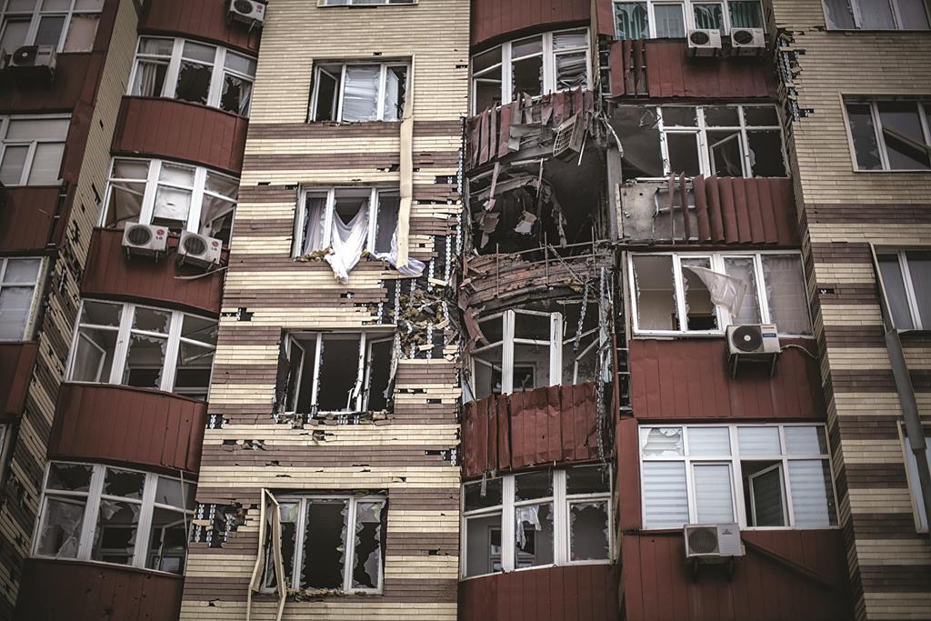 A building hit by the Ukrainian Army Artillery is seen in Voroshilovsky area, center of Donetsk, Ukraine, on Sunday. (AP Photo/Manu Brabo)